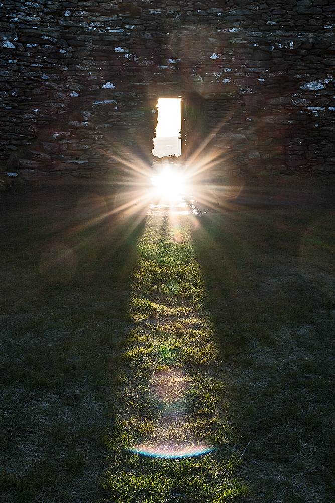 The sun's refection in a puddle outside the gate at 7.33 am.